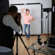 Stock Photo: Photographer shooting model