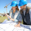 Architects looking at blueprint — Stock Photo