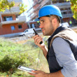 Foreman with tablet and  walkie talkie — Stock Photo