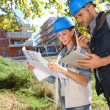 Construction engineers with scheme  — Stock Photo