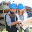 Construction engineers looking at blueprint — Stock Photo