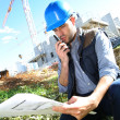 Construction manager using walkie-talkie — Stock Photo