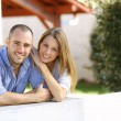 Couple in front of home — Stock Photo