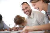Happy people filling admission form — Stock Photo