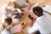 Business people using electronic devices — Stock Photo