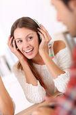 Young woman in headphones — Stok fotoğraf