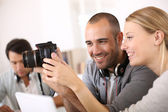 Young smiling photographers — Stock Photo