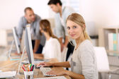 Young girl in office working — Stock Photo