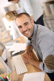 Smiling office worker — Stock Photo