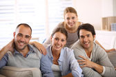 Friends sitting at sofa — Stock Photo
