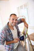 Cheerful man in new apartment — Stock Photo