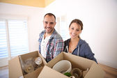 Young adults packing stuff — Stock Photo