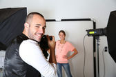 Smiling photographer and model — Stock Photo