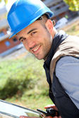 Construction manager with walkie-talkie — Stock Photo