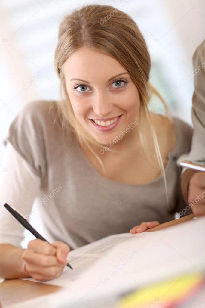 Smiling girl filling <b>application form</b> for business school — Photo by Goodluz - depositphotos_36651609-Girl-filling-application-form