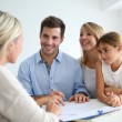 Stock Photo: Family meeting real-estate agent
