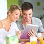 Couple reading news — Stock Photo #38960525