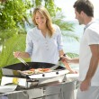 Couple preparing grilled food — Stock Photo #38961831