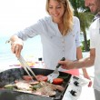 Couple preparing grilled food — Stock Photo #38961995