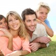 Portrait of family in summer time — Stock Photo