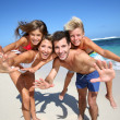 Parents giving piggyback ride to kids — Stock Photo #38962269