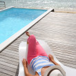 Stock Photo: Womrelaxing in deck chair