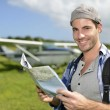 Stock Photo: Adventurer looking at tourist map