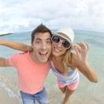Couple having fun at the beach — Stock Photo #38965373