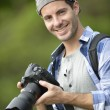 Stock Photo: Photo reporter on shooting day