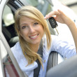 Woman showing car key — Stock Photo #38966037