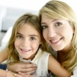 Stock Photo: Girl cuddling with her mom