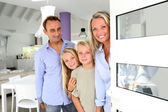 Family welcoming people at home — Stock Photo
