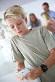 Boy playing with smartphone — Foto de Stock