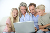 Family connected on internet — Stok fotoğraf