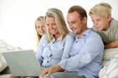 Family connected on internet — Stock Photo