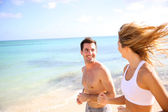 Couple training on the beach — Stock Photo