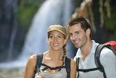 Trekkers reaching waterfall — Stock Photo