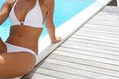 Woman's body in white bikini — Stock Photo