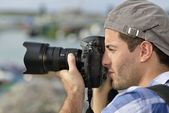 Photographer shooting outdoors scenery — Stock Photo