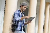 Adventurer looking at street map — Stock Photo