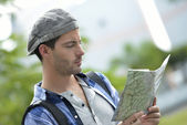Adventurer looking at street map — ストック写真