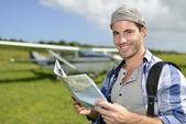 Adventurer looking at tourist map — Stock Photo