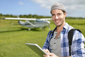 Adventurer using digital tablet — Stock Photo