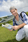 Adventurer looking at tourist map — Stock Photo