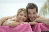 Couple relaxing in long chair — Stock Photo