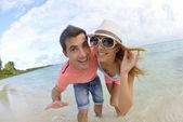 Couple having fun at the beach — Stock Photo