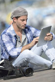 Globe-trotter using digital tablet — Stock Photo