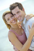 Couple embracing by the beach — Stock Photo