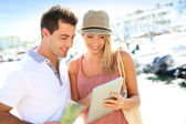 Couple looking at tourist information — Stock Photo