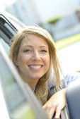Woman by car window — Stock Photo